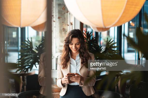 businesswoman check the email in the hotel - guest stock pictures, royalty-free photos & images