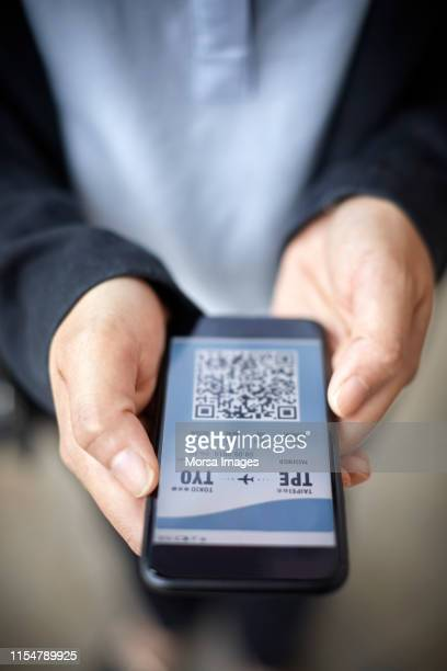 businesswoman checking her online airport ticket - airplane ticket stock pictures, royalty-free photos & images