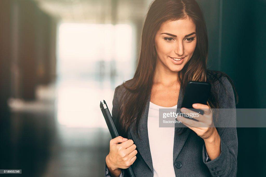 Businesswoman Checking Her Phone : Stock Photo