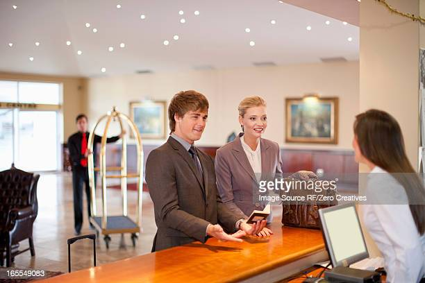 Businesswoman checking in to hotel