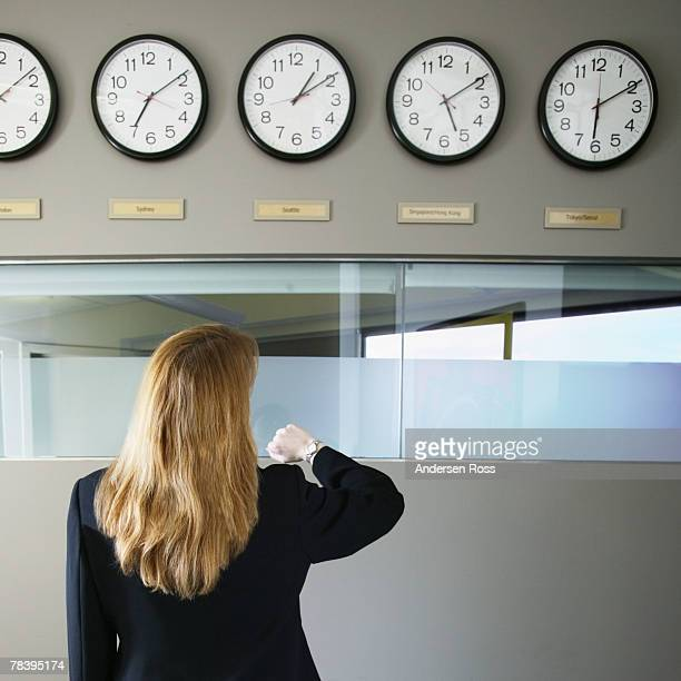 Businesswoman checking international time zones