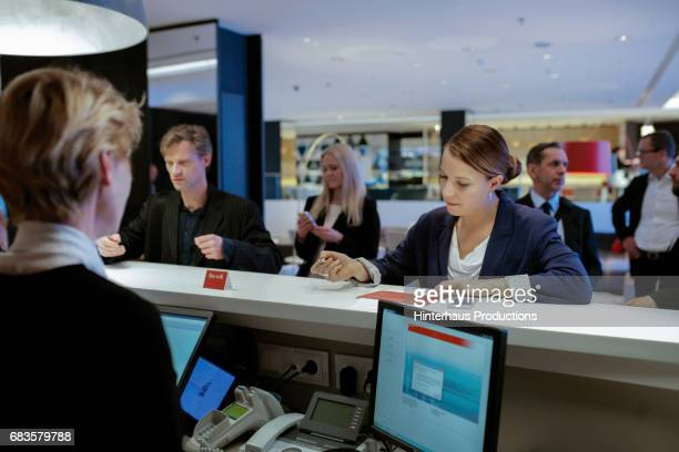 Businesswoman Checking Into Hotel At Reception