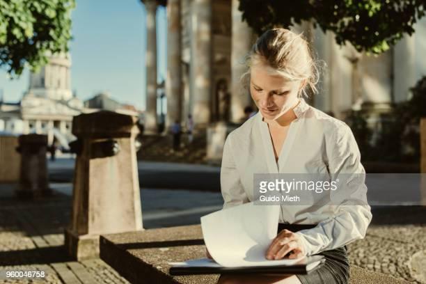 Businesswoman checking presentation.
