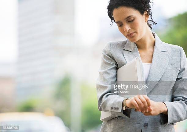 Businesswoman checking watch
