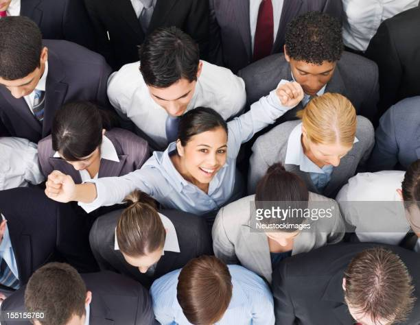 Businesswoman Cheering in a Crowd