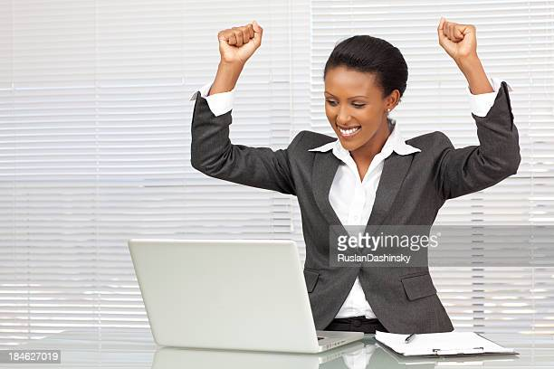 businesswoman cheering over good news .