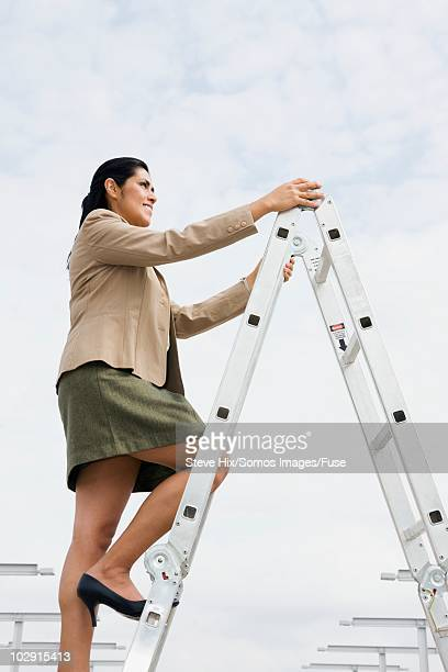 Businesswoman climbing a ladder