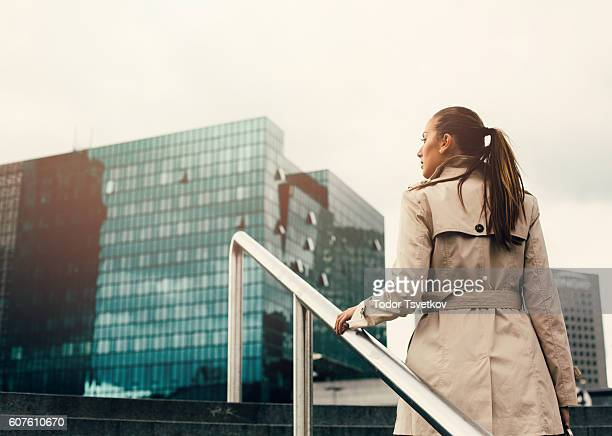 Businesswoman climbing up the stairs