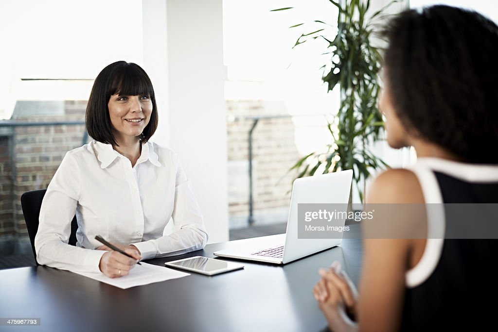 Businesswoman conducting an interview : Stock Photo