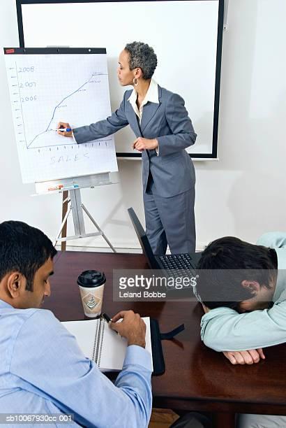 Businesswoman conducting boring business meeting