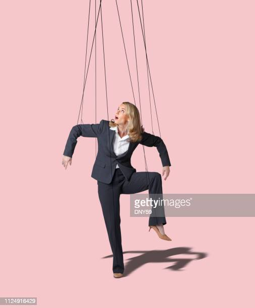 businesswoman controlled like a marionette - puppet stock pictures, royalty-free photos & images