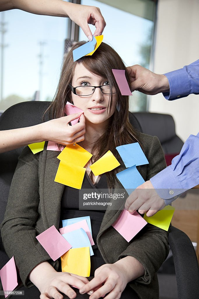 Businesswoman covered with sticky notes : Stock Photo