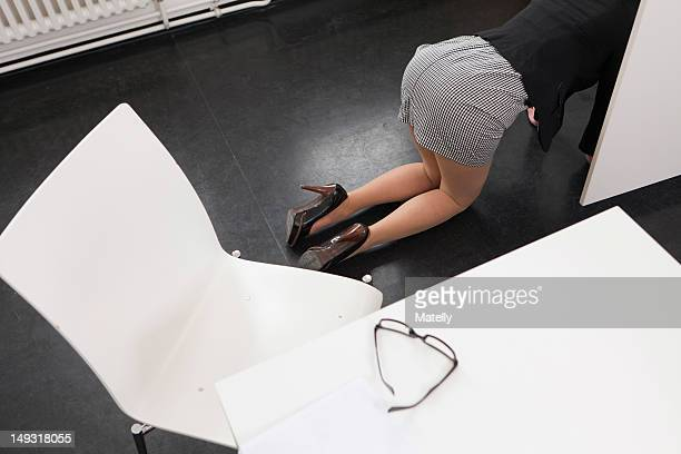 Businesswoman crawling on office floor