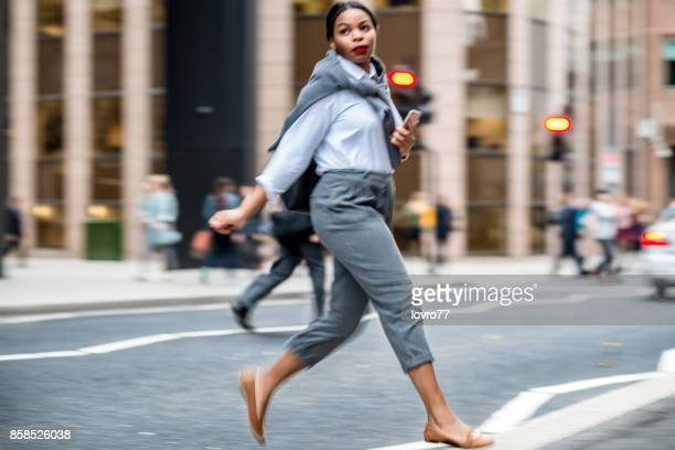 Businesswoman crossing road