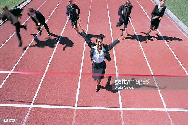 Businesswoman Crossing the Finish Line