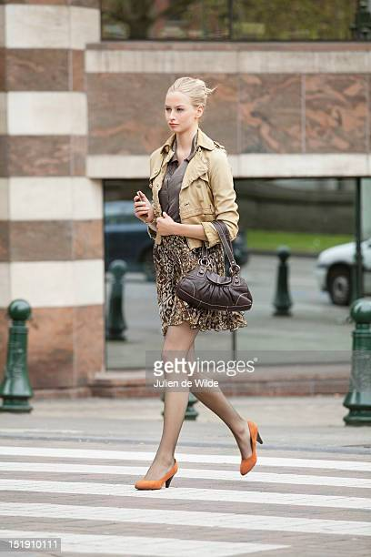 Businesswoman crossing the road