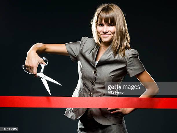 businesswoman cutting a red ribbon - opening event stock pictures, royalty-free photos & images