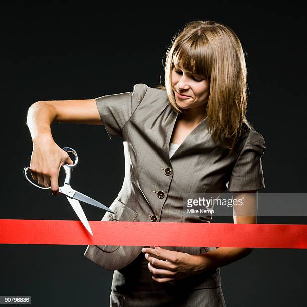 businesswoman cutting a red ribbon - opening event stock photos and pictures