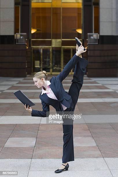 Businesswoman dancing in urban setting