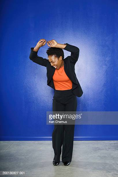 Businesswoman dancing