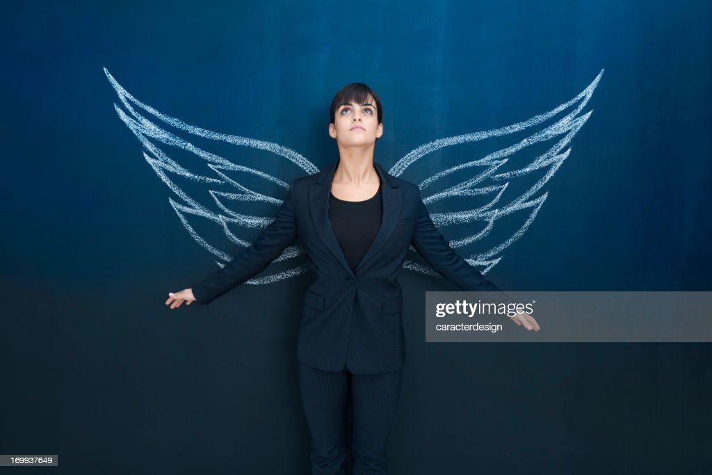 Businesswoman day dreaming : Stock Photo
