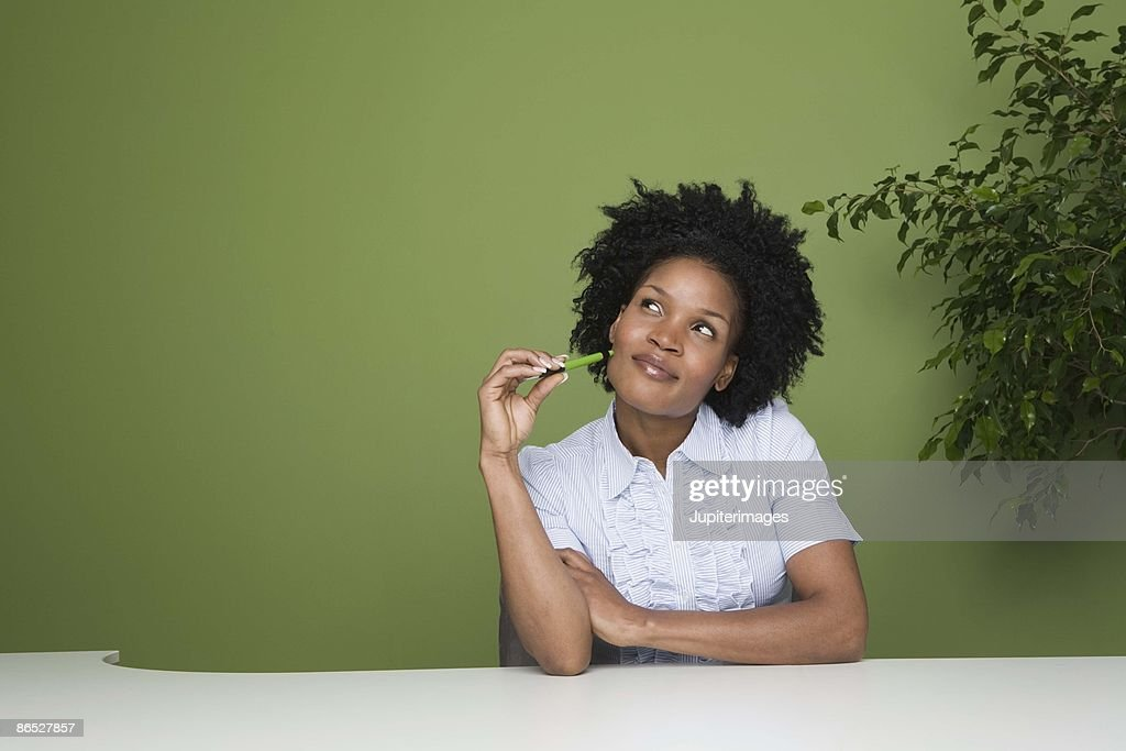 Businesswoman daydreaming : Stock Photo