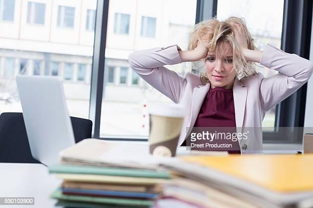 Businesswoman desperate in office