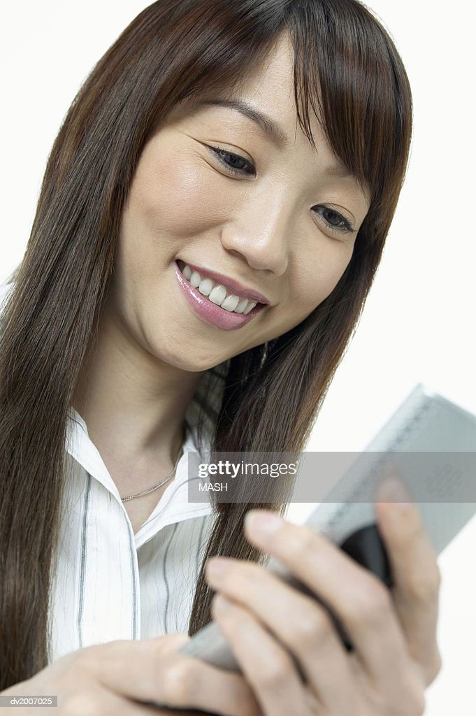 Businesswoman Dialing on Her Mobile Phone : Stock Photo