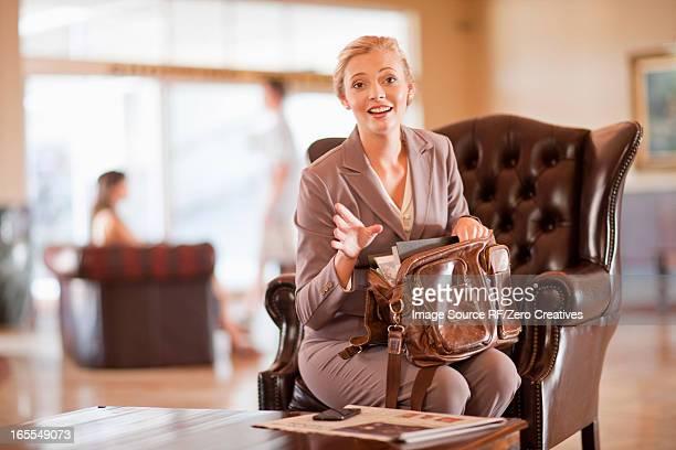 Businesswoman digging through purse