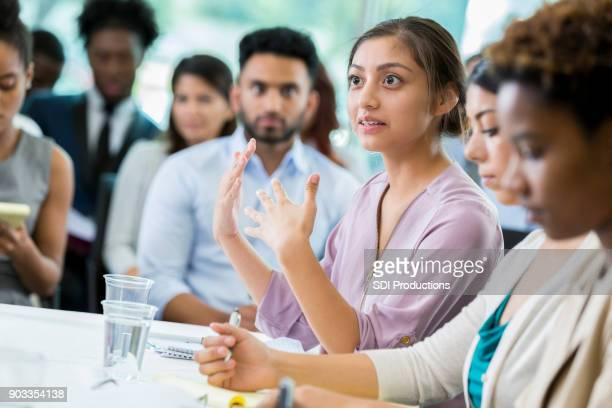 Businesswoman discusses something during seminar