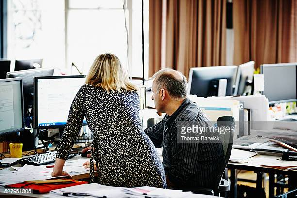 Businesswoman discussing project with colleague
