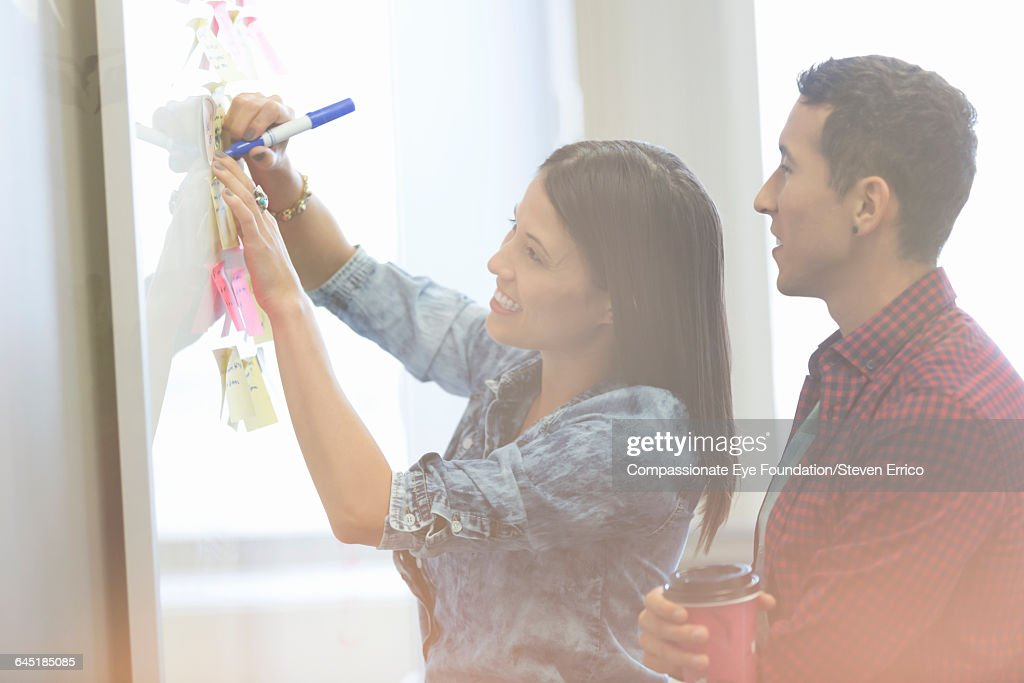Businesswoman discussing project with colleague : Stock Photo