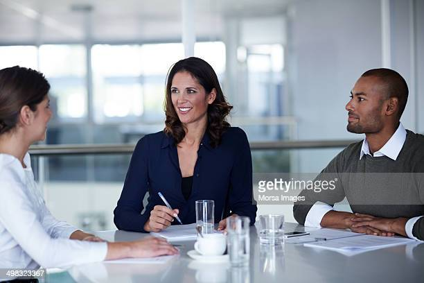 Businesswoman discussing with colleagues