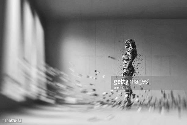 businesswoman disintegrating in the modern concrete office - sweeping stock pictures, royalty-free photos & images