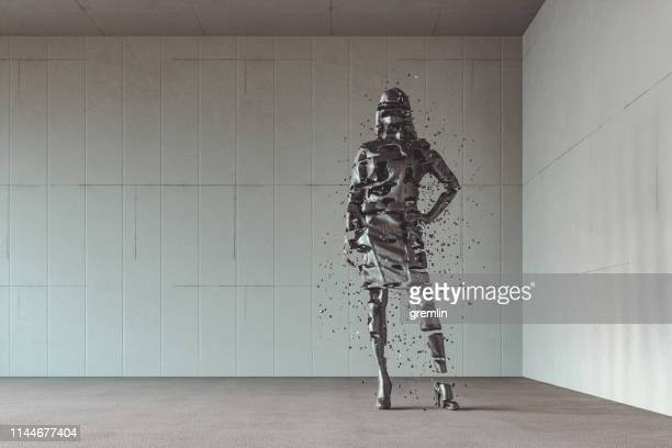 businesswoman disintegrating in the modern concrete office - disintegration stock photos and pictures