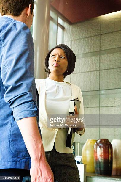 Businesswoman distraught by pre-meeting briefing in lobby