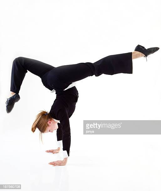 businesswoman doing a hand stand