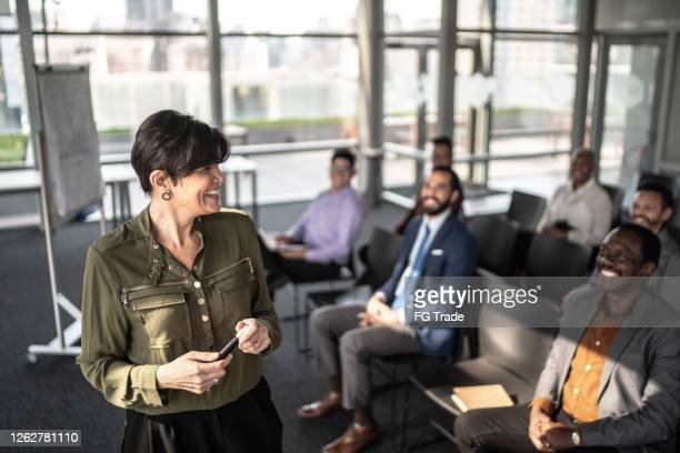 businesswoman doing a presentation to the team - candidate stock pictures, royalty-free photos & images