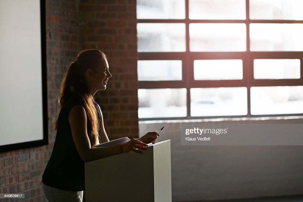 Businesswoman doing a talk at convetion : Stock Photo