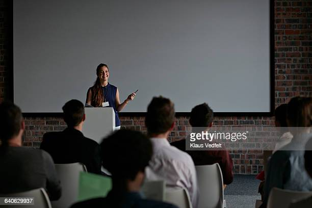 Businesswoman doing a talk at convetion