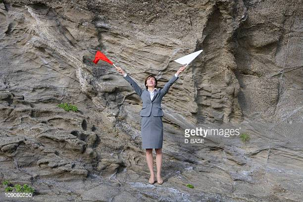 businesswoman doing  flag signaling on the cliff - semaphore stock pictures, royalty-free photos & images