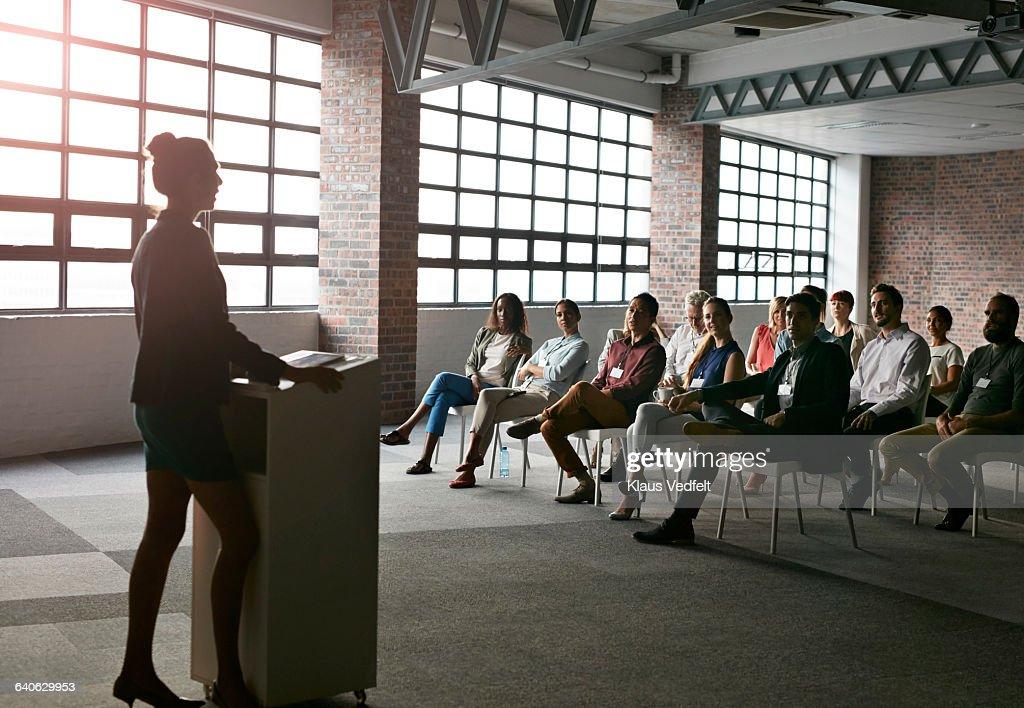 Businesswoman doing presentation in auditorium : Stock Photo