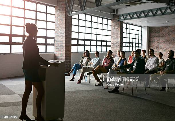 Businesswoman doing presentation in auditorium