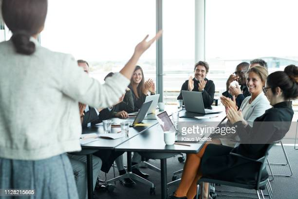 businesswoman doing presentation in big boardroom - successo foto e immagini stock