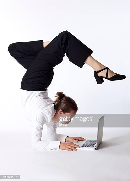 businesswoman doing yoga on laptop