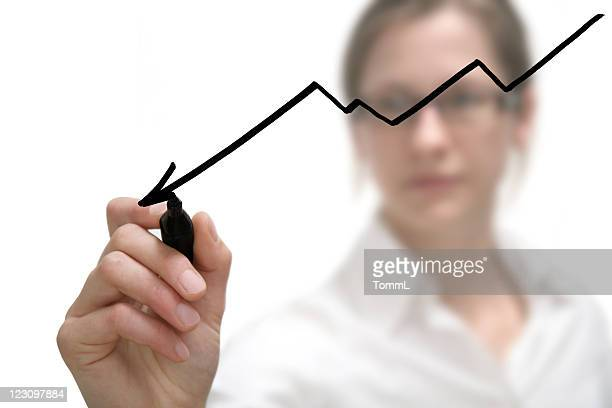 businesswoman drawing graph