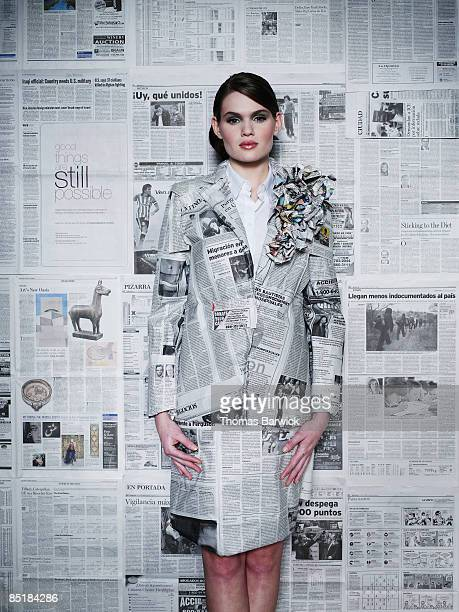 Businesswoman dressed in newspaper suit