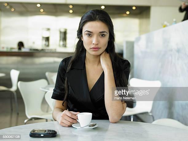 Businesswoman Drinking Espresso