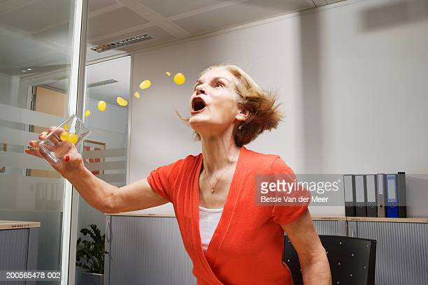 Businesswoman drinking orange juice