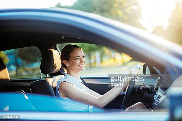 businesswoman driving a car - driver stock photos and pictures